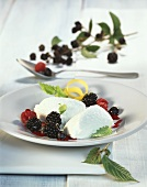Lemon mousse with fruits of the forest