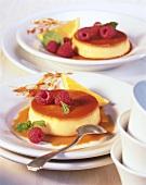 Orange custard with raspberries
