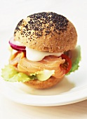 Salmon burger with red onion, tomatoes and avocado
