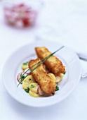 Breaded salmon escalopes on potato and radish salad