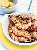 Fried shrimps with garlic and herb butter