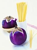 Round aubergines and spaghetti
