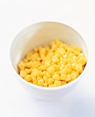 Sweetcorn kernels in a small white bowl