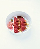 Raw tuna fillet with sesame seeds and soy sauce