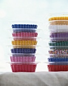 Coloured sugar in plastic containers