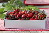 Cherries in a cardboard box
