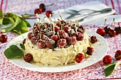 Sponge cake with sugared cherries