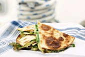 Quesadillas (filled tortillas) with cheese and rocket