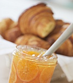 Mandarin orange jam in jar and croissants