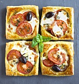 Pizza slices with tomatoes, mozzarella and olives