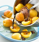 Putting poached peaches into a bowl
