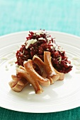 Sausages with beetroot risotto and Parmesan