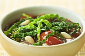 Savoy cabbage stew with beans and tomatoes