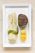 White asparagus with fillet steak and saffron potatoes