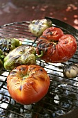 Tomatoes, peppers and garlic on a barbecue
