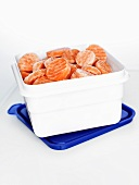Frozen carrot slices in plastic box