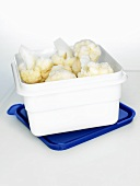 Frozen cauliflower in a plastic box