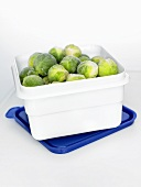 Frozen Brussels sprouts in a plastic box