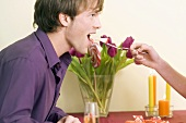 Man being fed cake