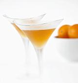 Two orange Martinis