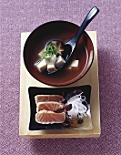 Miso soup with tofu, salmon and radish