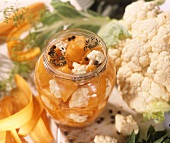 Carrots and cauliflower in vinegar in a preserving jar
