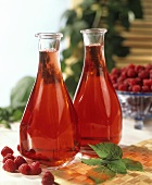 Two bottles of raspberry juice