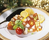 Christmas carp in jelly with tomatoes and peas