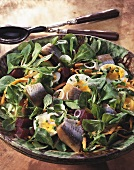 Corn salad with beetroot and herring fillet