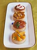 Four fruit tartlets on a platter