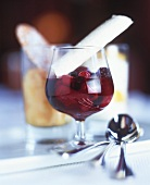 Red fruit compote in a glass