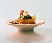 Baked pasta shell with prawns and spinach