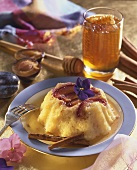 Rice pudding with plums and honey sauce