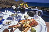 Spiny lobster on laid table on hotel terrace (Caribbean)