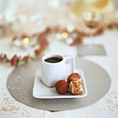 A cup of coffee and chocolate truffles