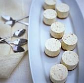 Vanilla cream 'cheesecakes' on biscuits