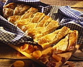 Filled yeast cake with dried apricots and raisins