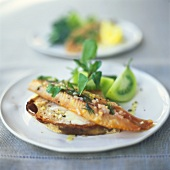 Smoked trout fillet on a slice of bread and butter