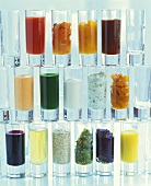 Wall of glasses containing different small appetisers
