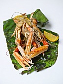 Steamed scampi with lemon in banana leaf