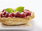 Raspberry puff pastry tart with icing sugar