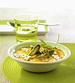 Carrot soup with goat's cheese and green asparagus