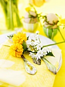 Easter place-setting with flowers and boiled eggs