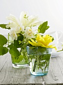 Table decoration of spring flowers in glasses