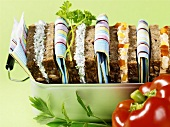 Soft cheese sandwiches with herbs and peppers