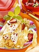 Pancake rolls with strawberry and lemon cream