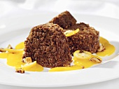 Hazelnut and pumpernickel pudding with fruit sauce
