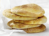 Five pita breads on greaseproof paper