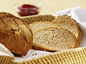 Mixed rye and wheat bread, partly sliced, in bread basket