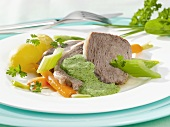 Boiled beef with vegetables and green (herb) sauce